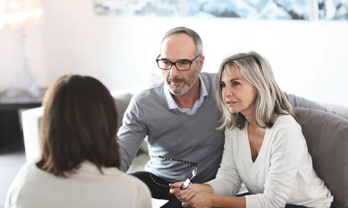 An older couple speak with a broker