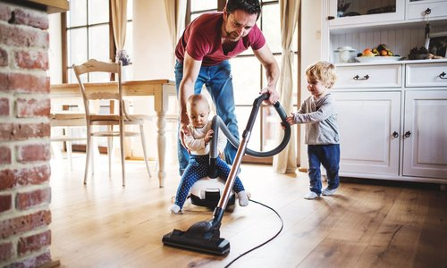 """A dad tries to vacuum while his two toddlers """"help"""""""