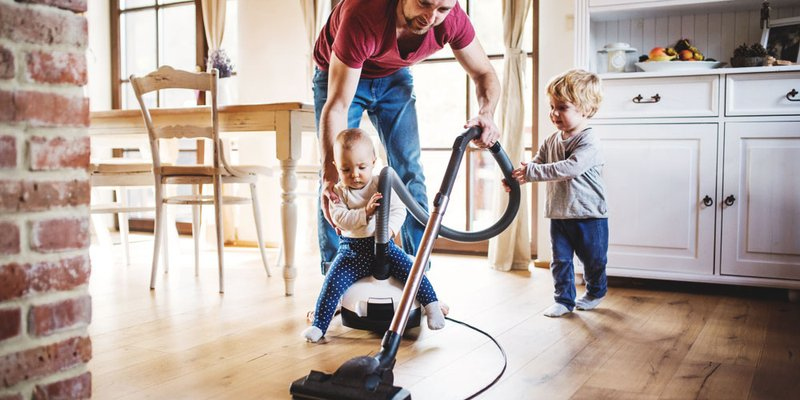 "A dad tries to vacuum while his two toddlers ""help"""