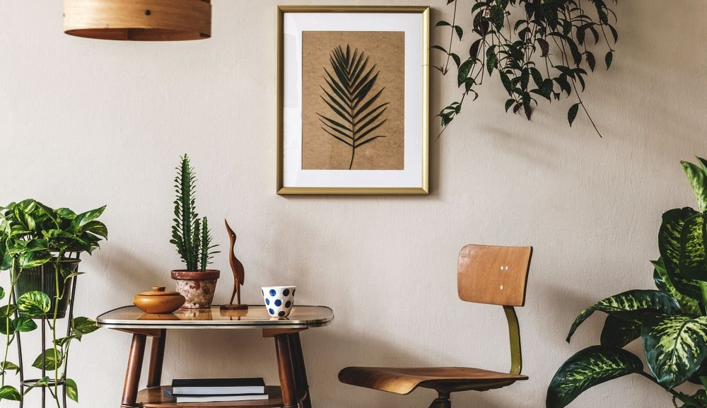modern home interior shows a workspace with lots of plants around it