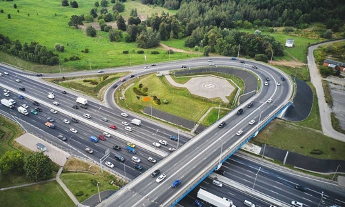 Aerial shot of on-ramp to major highway with lots of traffic