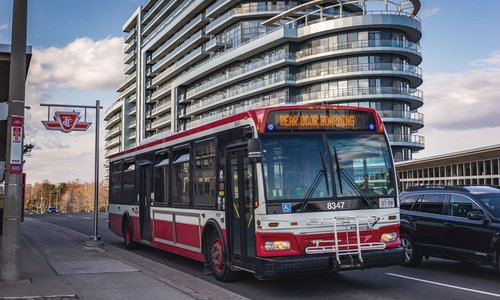 A TTC bus pulling up to the stop