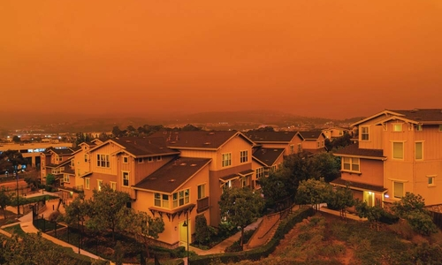 A town coated in thick orange smoke