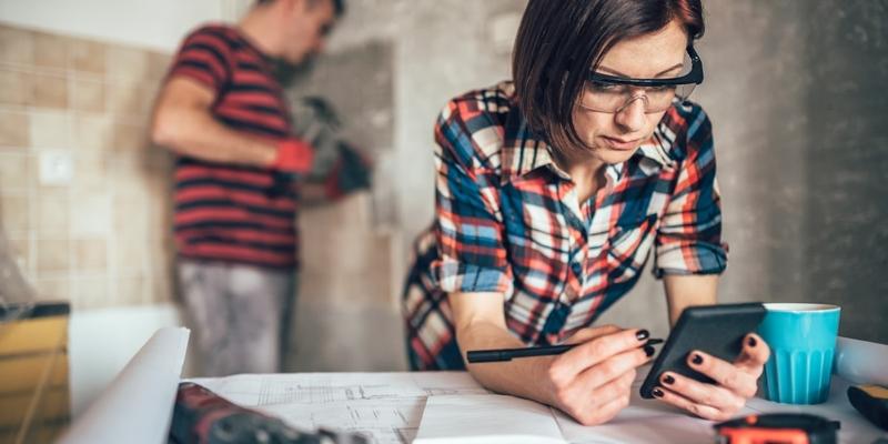 Woman checking renovation blueprints