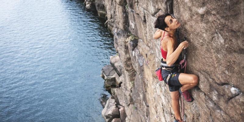 Woman rock-climbing a mountain