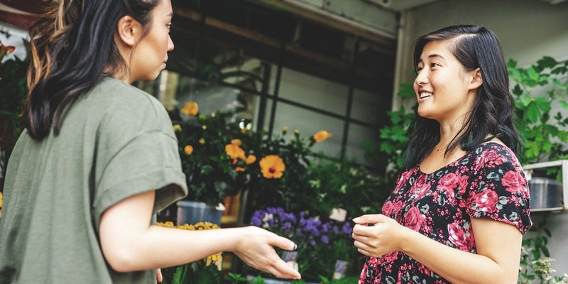 friends at a garden centre choosing flowers