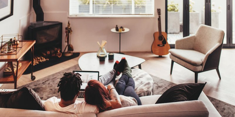 Couple in modern living room at home