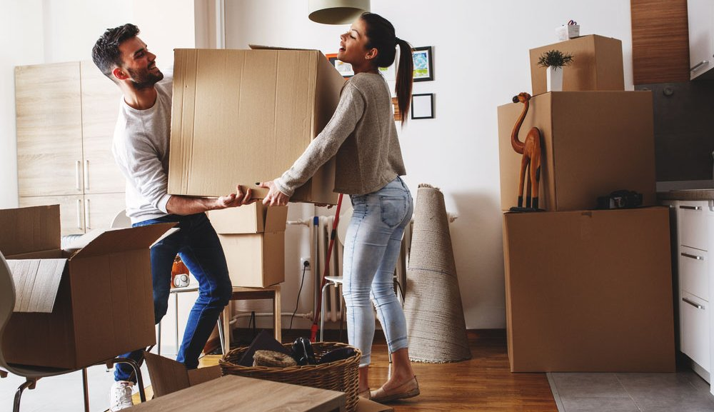 Couple moving into their new apartment