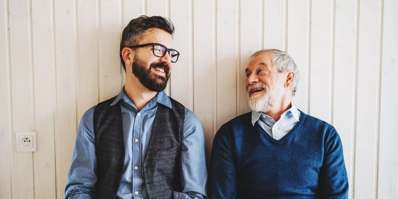 Grown man and father enjoying time together in candid portrait