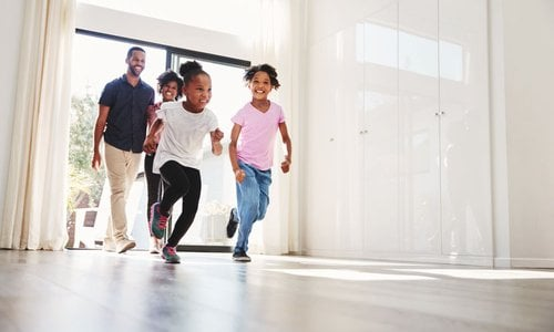 young family moving into their new place with lots of space and no furniture yet