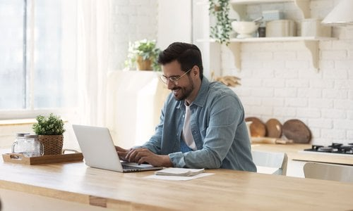 Man working from home at his modern kitchen island