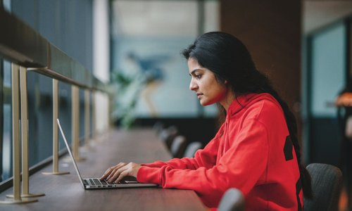 Woman working at a coworking space on her laptop