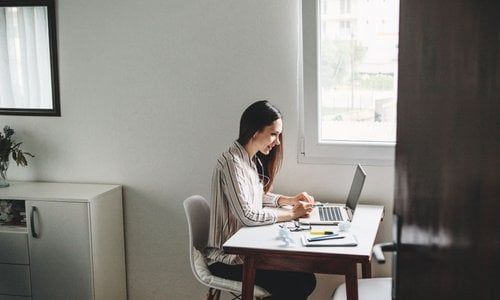 Modern woman working from her home office