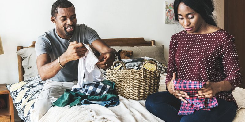 A couple folding the laundry together