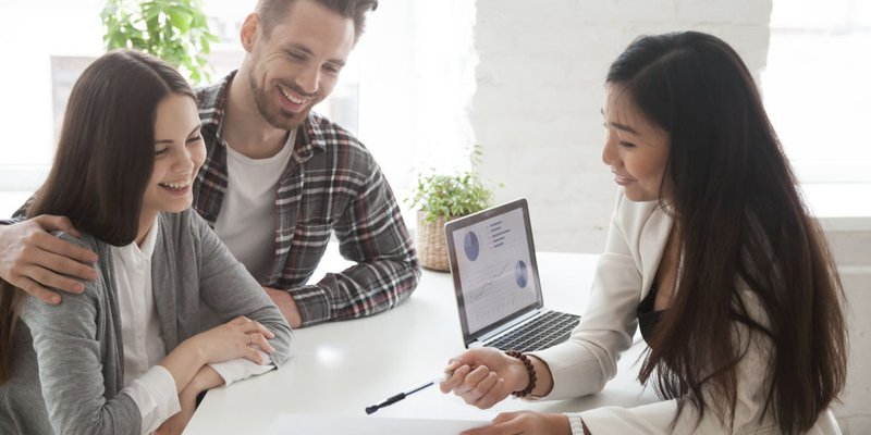 A young couple speaking with a financial advisor