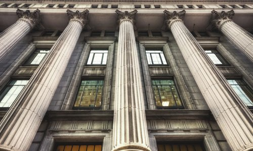 A view of a bank's exterior with grand pillars