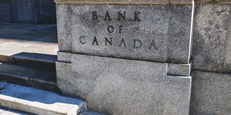 A large concrete wall with The Bank of Canada engraved on it