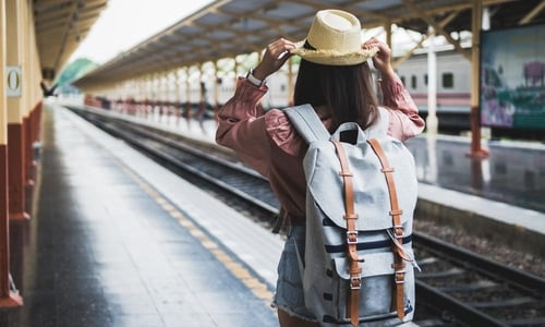 A backpacker waits for a train at the station
