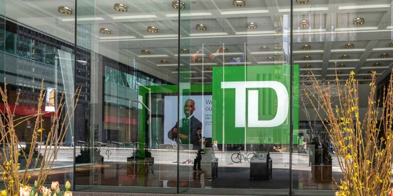 The view from outside a glass window at a TD bank branch