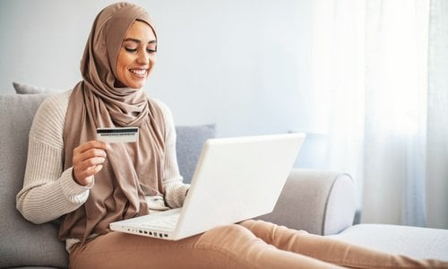 A woman uses her credit card for online shopping