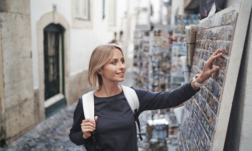 A woman looks at souvenirs outside a shop
