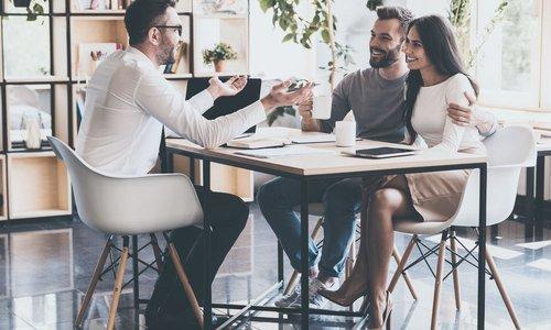 A couple meet with a financial advisor