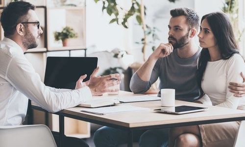 A couple speak with a mortgage broker