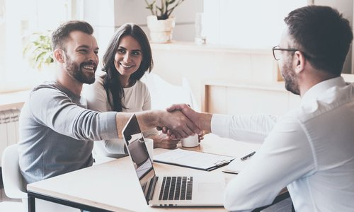 A man shakes hands with a mortgage broker